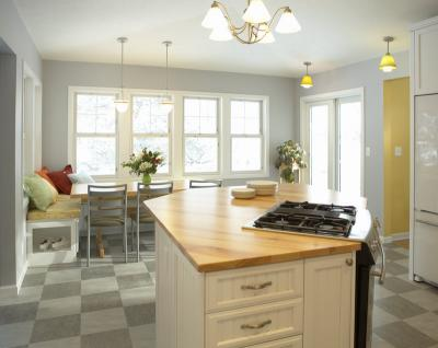 This once drafty kitchen is far more comfortable even with the addition of more windows and doors.